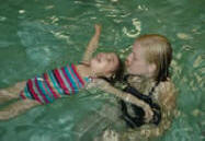 Child floating with instructor